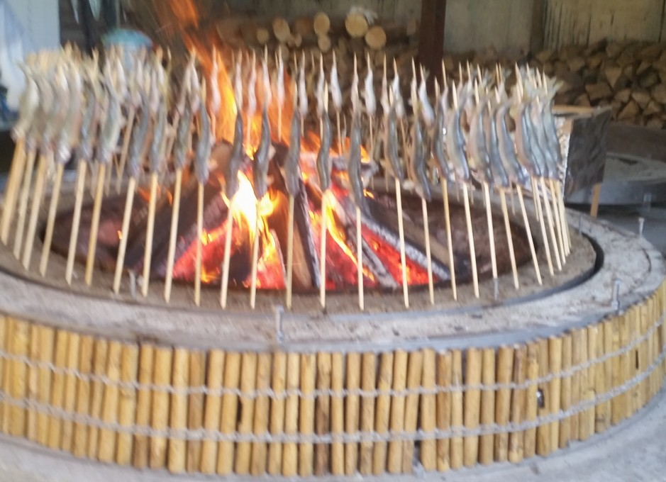 Ayu are slow-roasted on skewers over a wood fire