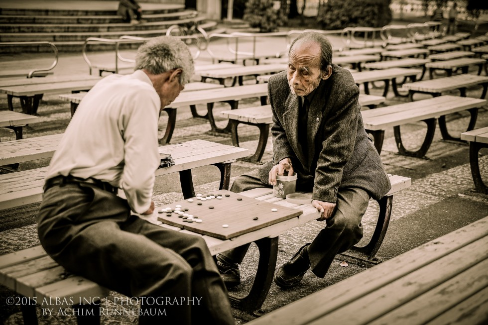 Two men playing GO