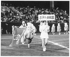 A representative holds a sign for the Potato Republic during the Micronation Olympics