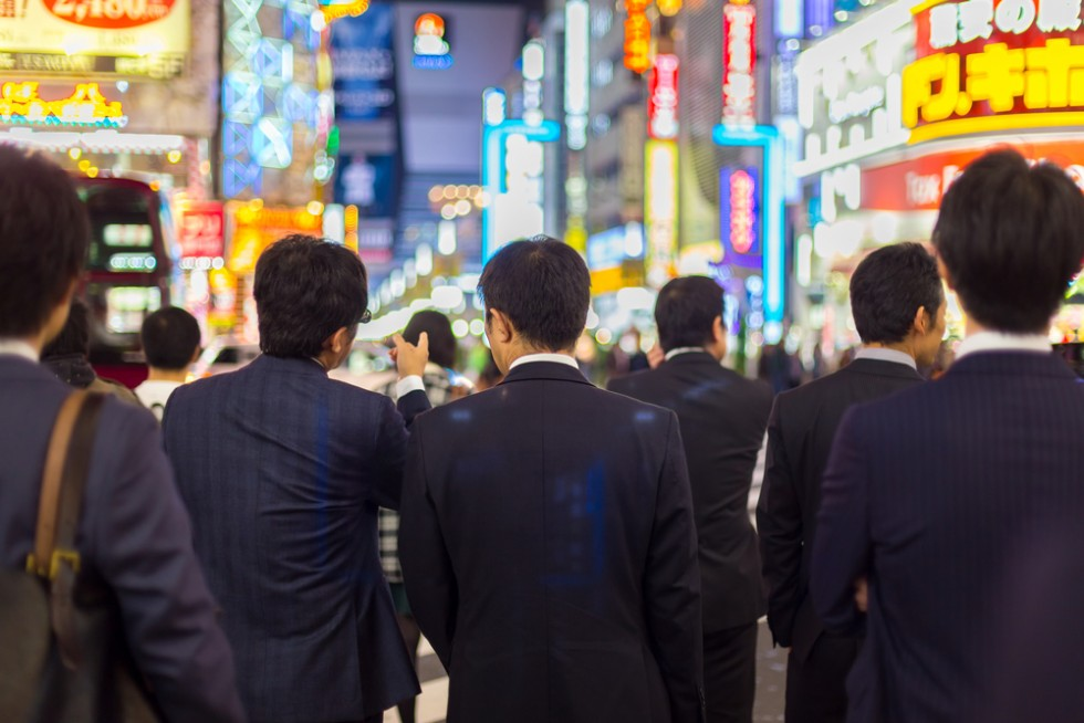 Young Japanese graduates in suits