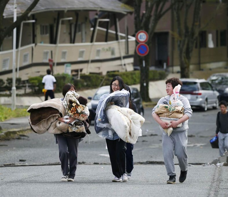 Survivors of the earthquake walking towards an uncertain future. Image from: http://www.nbcnews.com/news/world/magnitude-7-0-earthquake-strikes-japan-n556691