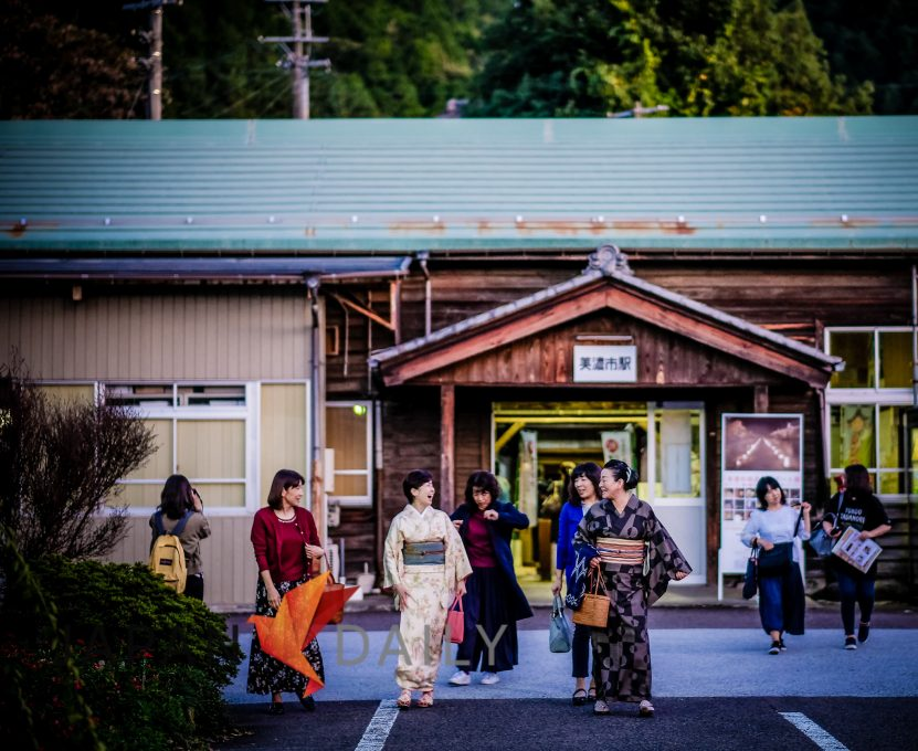 Women dressed in Yukata exiting a station