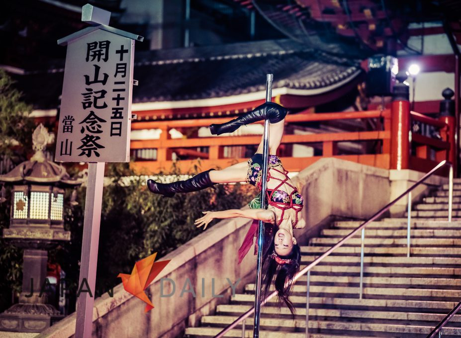 Pole Dancer in front of Osu Temple