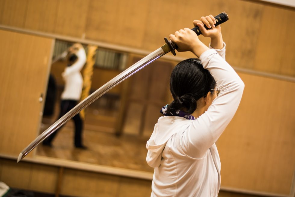 new practitioner of iaido using her katana